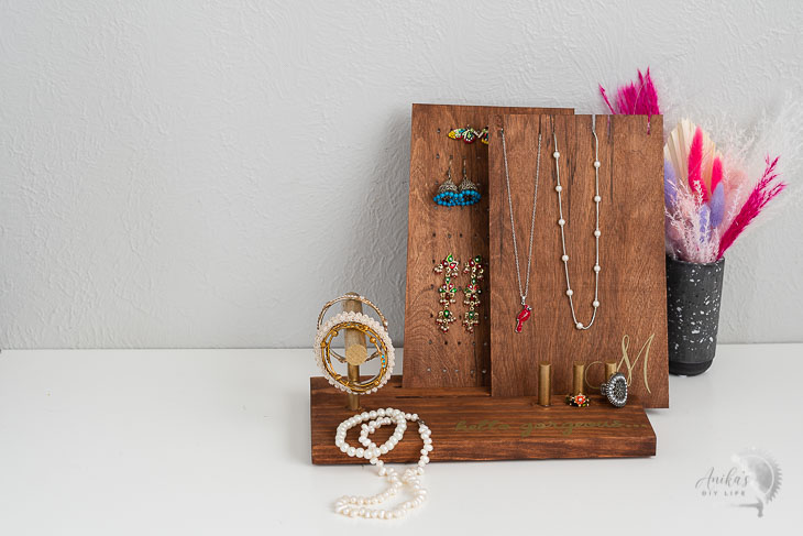 DIY Jewelry holder  with jewelry on a table