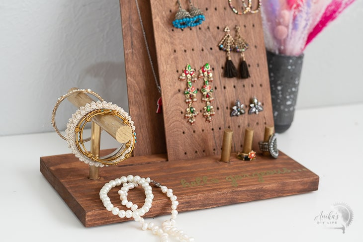 close up of the DIY jewelry stand with jewelry on it.