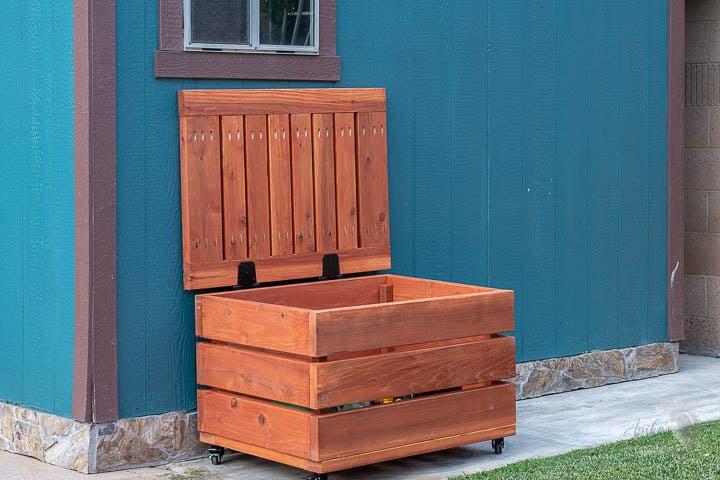 DIY Outdoor storage box open in the backyard
