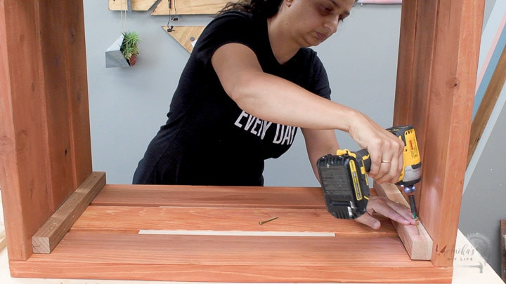 Woman building the outdoor storage box