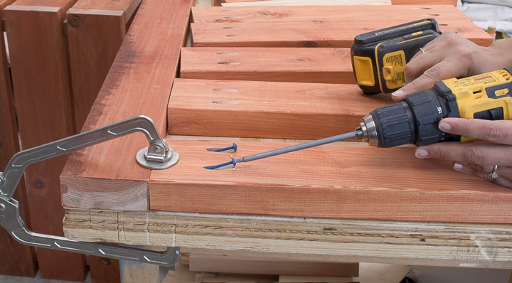 Attaching slats for the top of the Outdoor storage bench