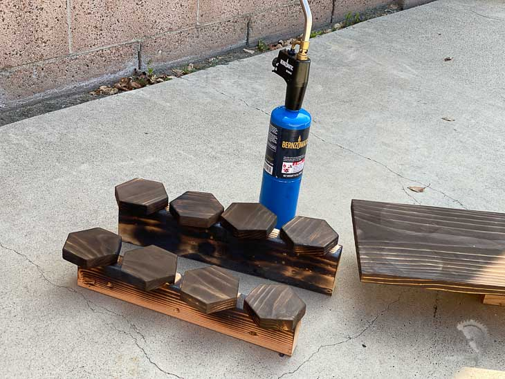 wood burnt boards and Bernzomatic torch