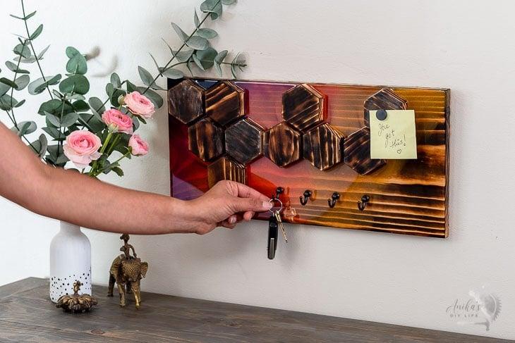 woman hanging keys on the keyholder