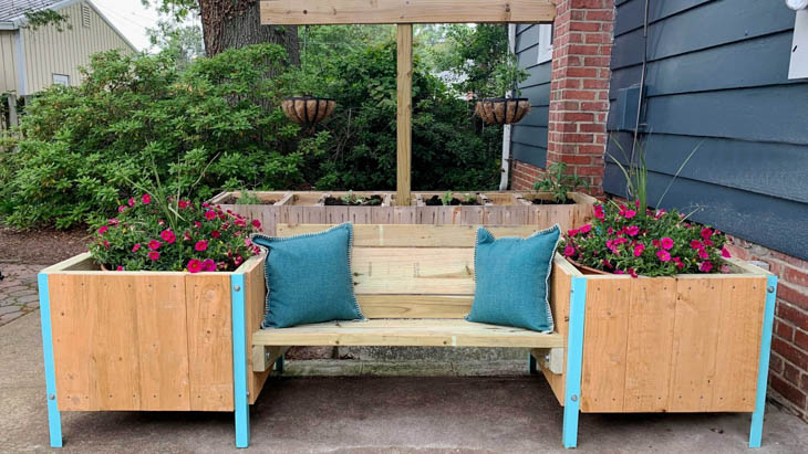 outdoor bench with raised wooden planer boxes attached to the ends