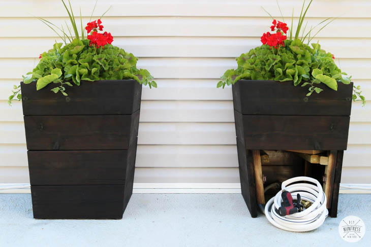 tapered wood planter boxes with garden hose storage in the bottom
