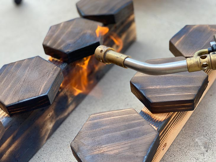 torching wood using a blow torch