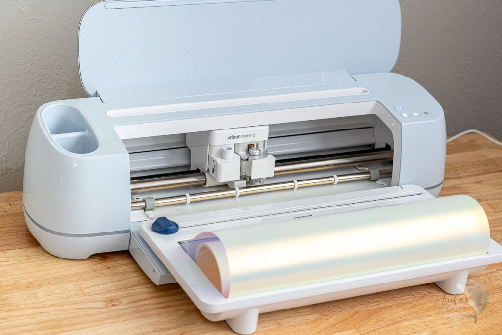 Cricut Maker 3 cutting holographic iron-on using a roll holder