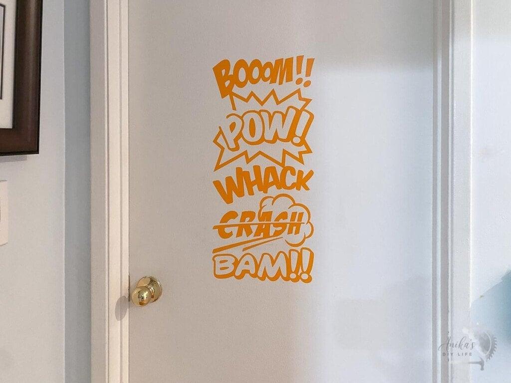 Door with orange comic book word art.