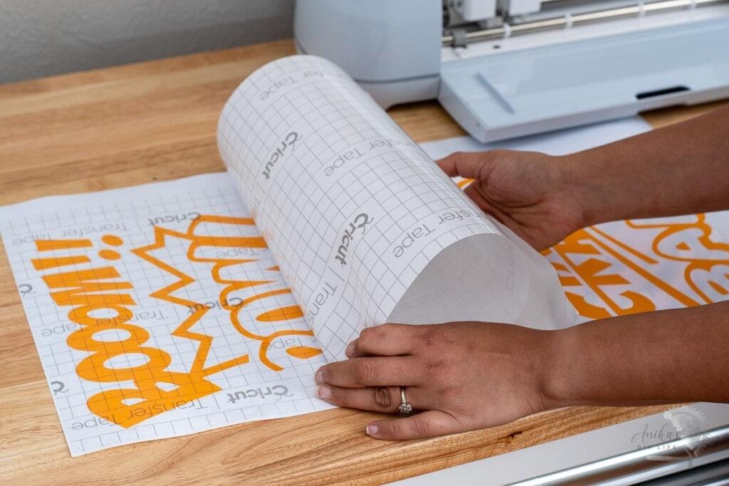 Woman transferring design cut on Cricut Maker 3onto Transfer Tape