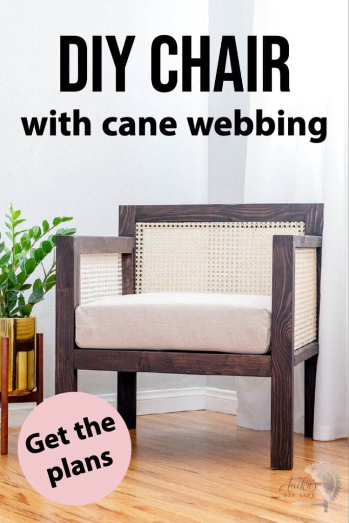 Brown chair with cane webbing in arm and back in room with colorful pillow and plant next to it with text overlay