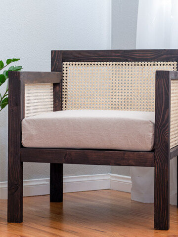Learn how to make a DIY wooden chair with cane webbing back and arms with the step-by-step tutorial and plans. This DIY armchair makes the perfect addition to any living room.