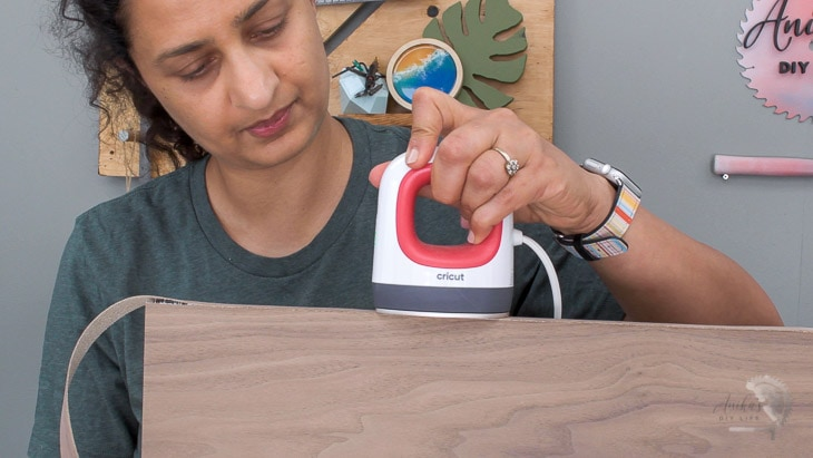 Woman applying edge-banding to plywood using the EasyPress Mini