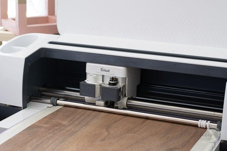 Cricut machine cutting  walnut veneer for diy dresser drawer fronts