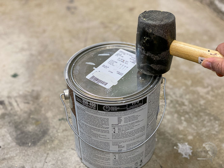 tapping the paint can with a mallet instead of a hammer
