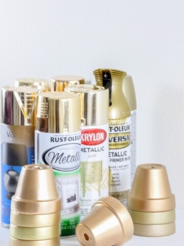 gold spray paint cans with terracotta pots spray painted gold