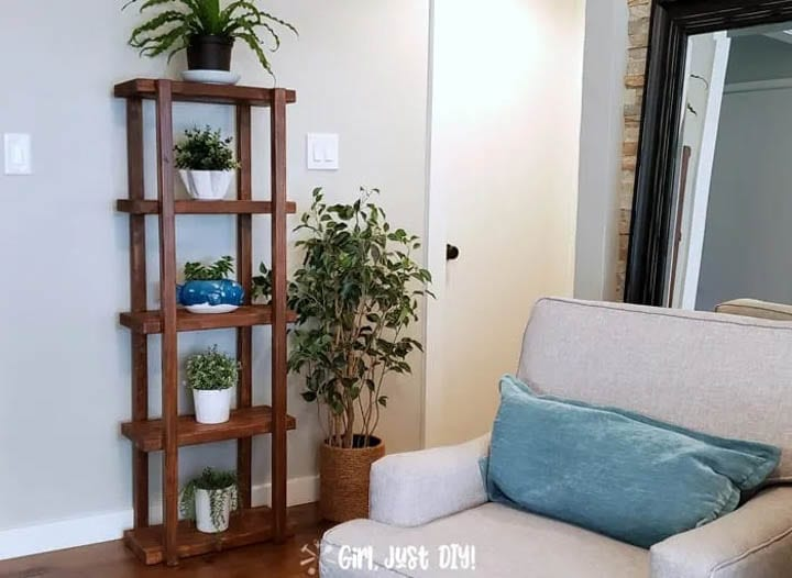 DIY plant stand made from 2x4s with five shelves