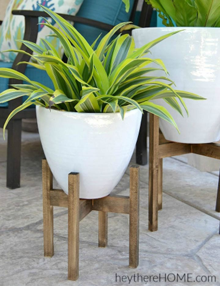 wood DIY plant stand with plant in white pot