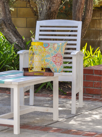 white patio chair and table in a backyard