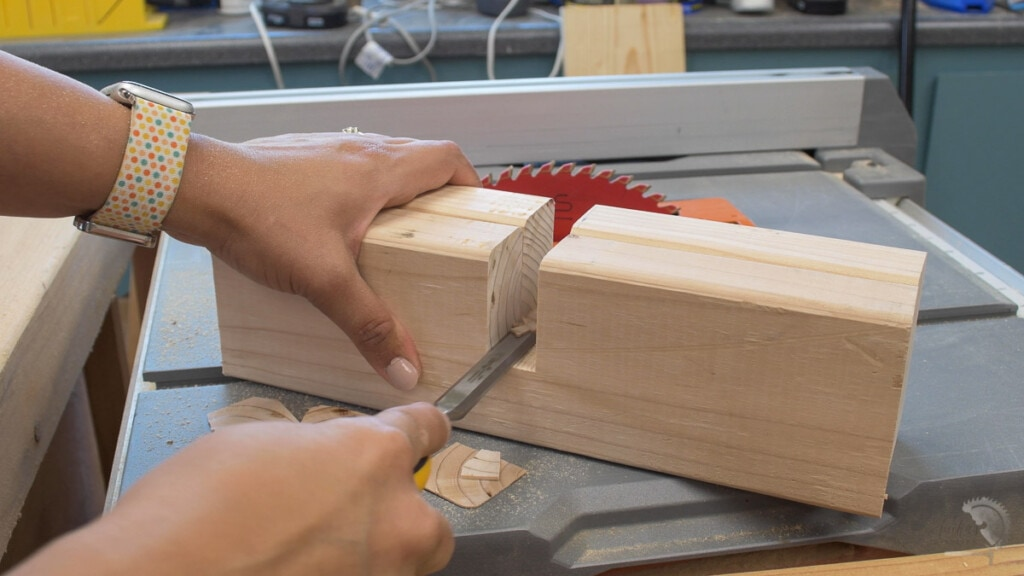 Cleaning out the slot on the 2x4 boards with a chisel