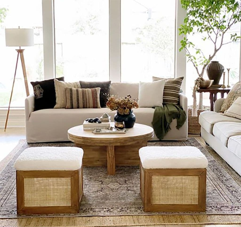 living room with two ottomans made with cane webbing