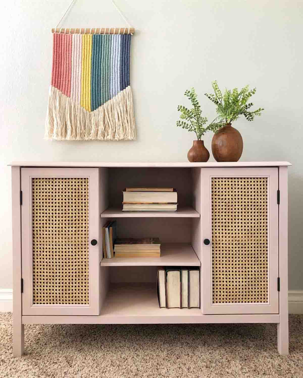 pink painted console with cane webbing doors.