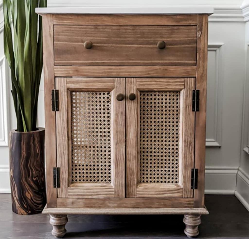 wood bathroom vanity with cane webbing doors