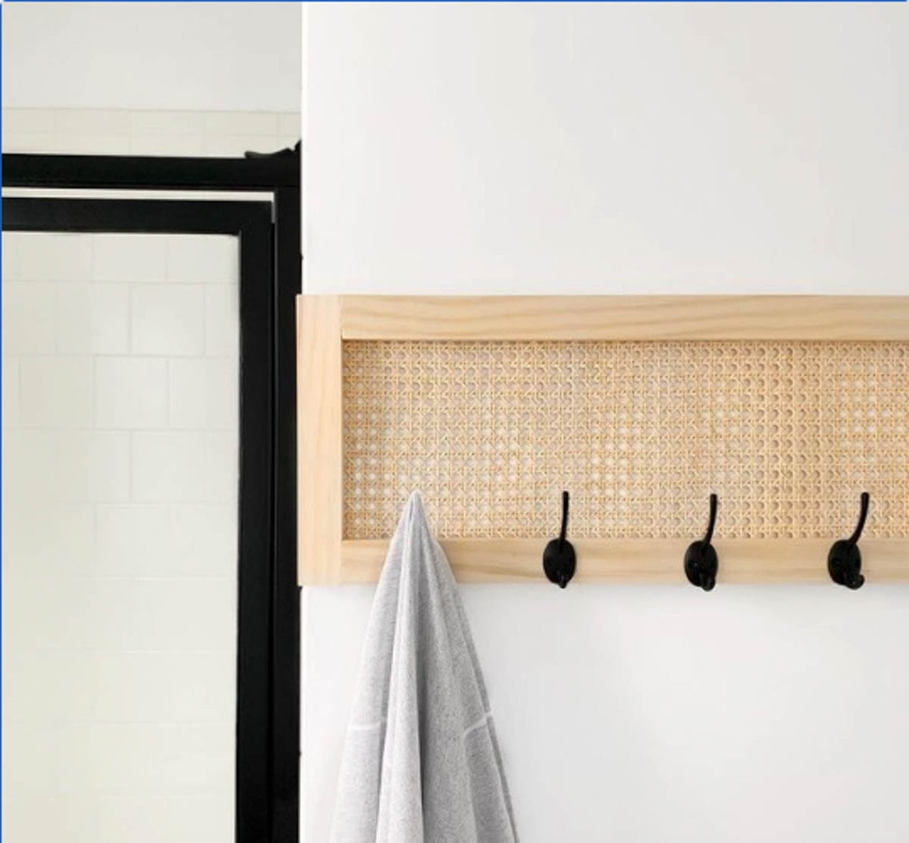 Wall-mounted towel rack made with cane webbing