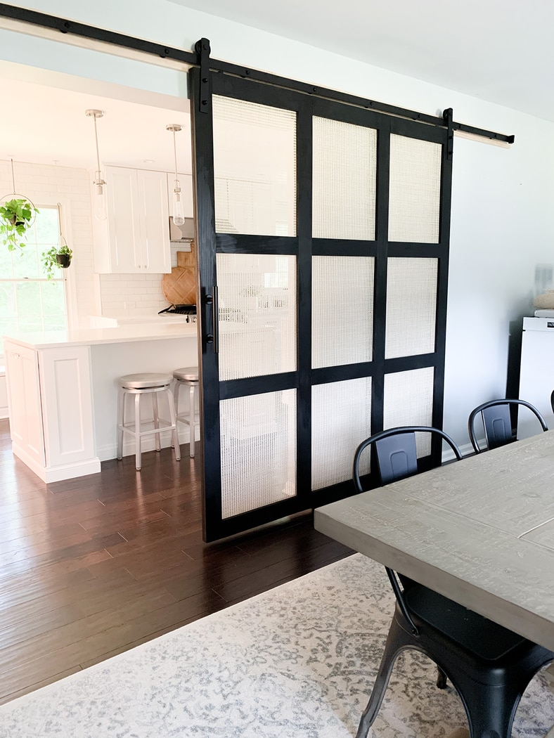 sliding door with cane webbing panels between the dining room and kitchen