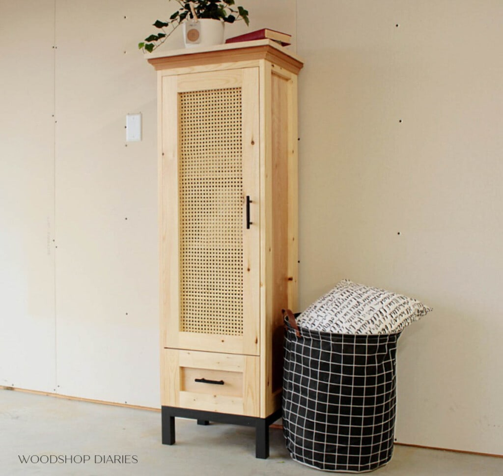 Linen cabinet with drawer and doors in cane webbing panel