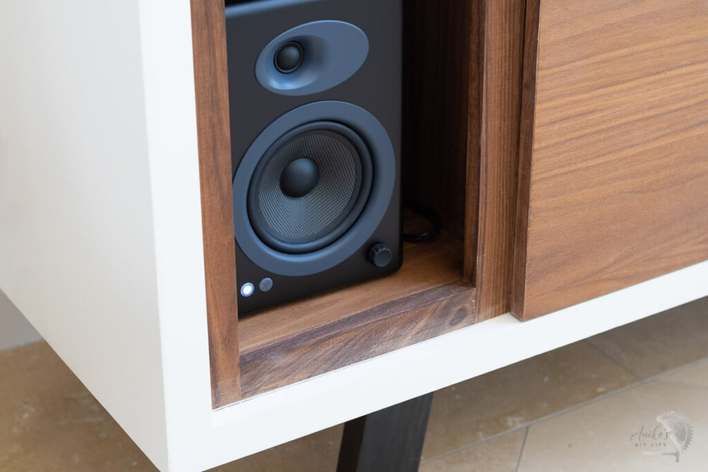 Close up of the speaker compartment of the record player cabinet
