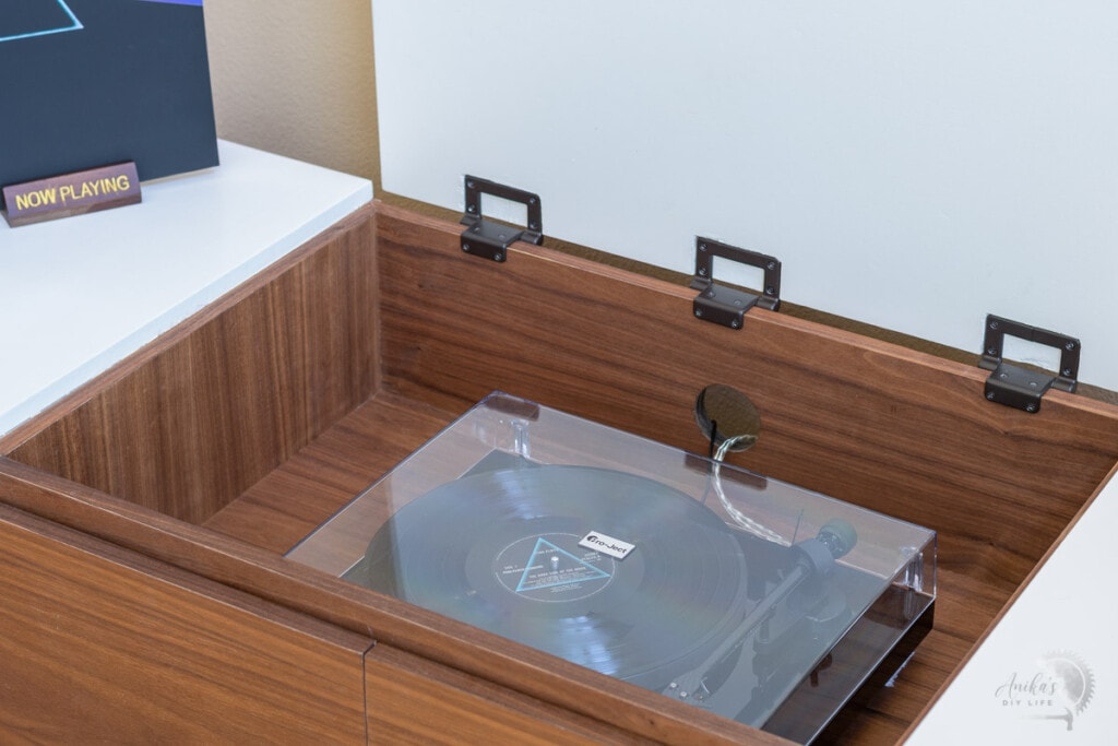 Record player compartment with record player inside it