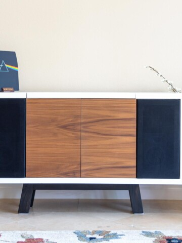 Learn how to build an amazing DIY record player stand with space for speakers and storage for vinyl records with detailed tutorial and plans.