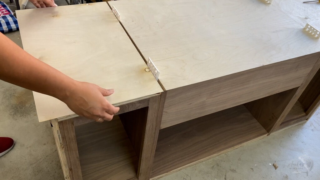 Woman attaching plywood to the record player cabinet