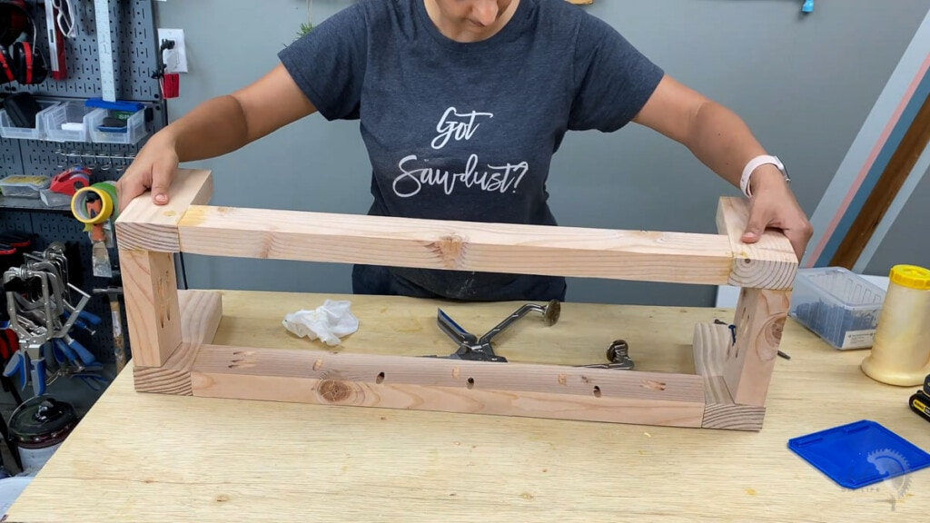 Woman building the stand for the turntable console