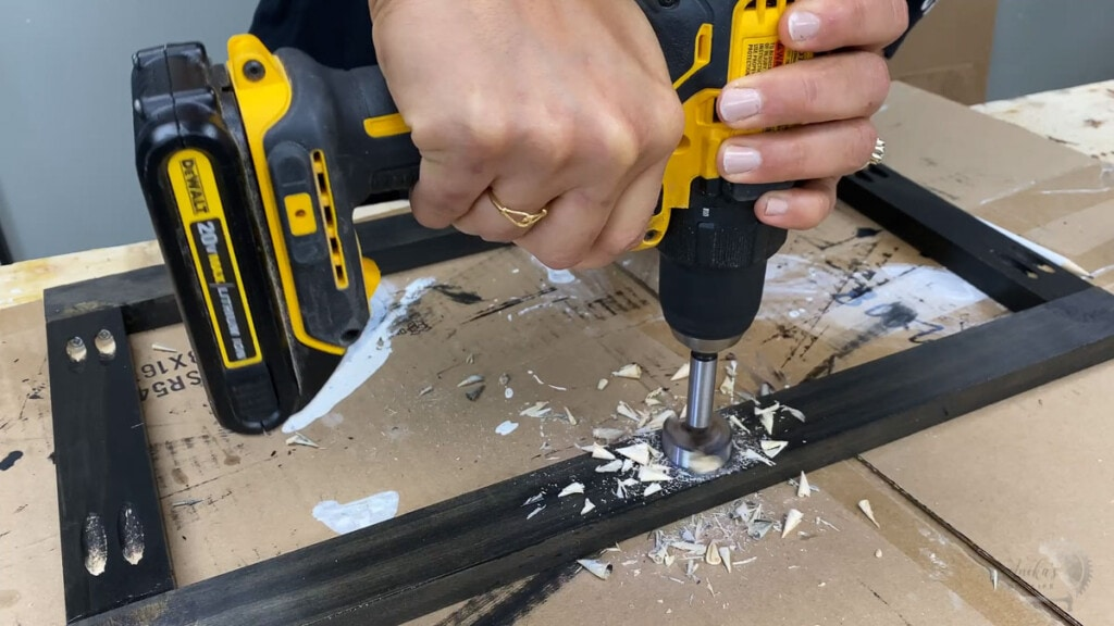 woman using forstener bit to make holes in the board