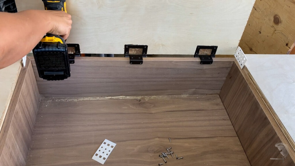 Attaching cabinet top door