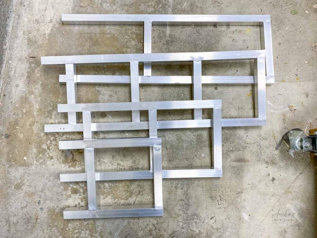 Brazed aluminum frames on workshop floor