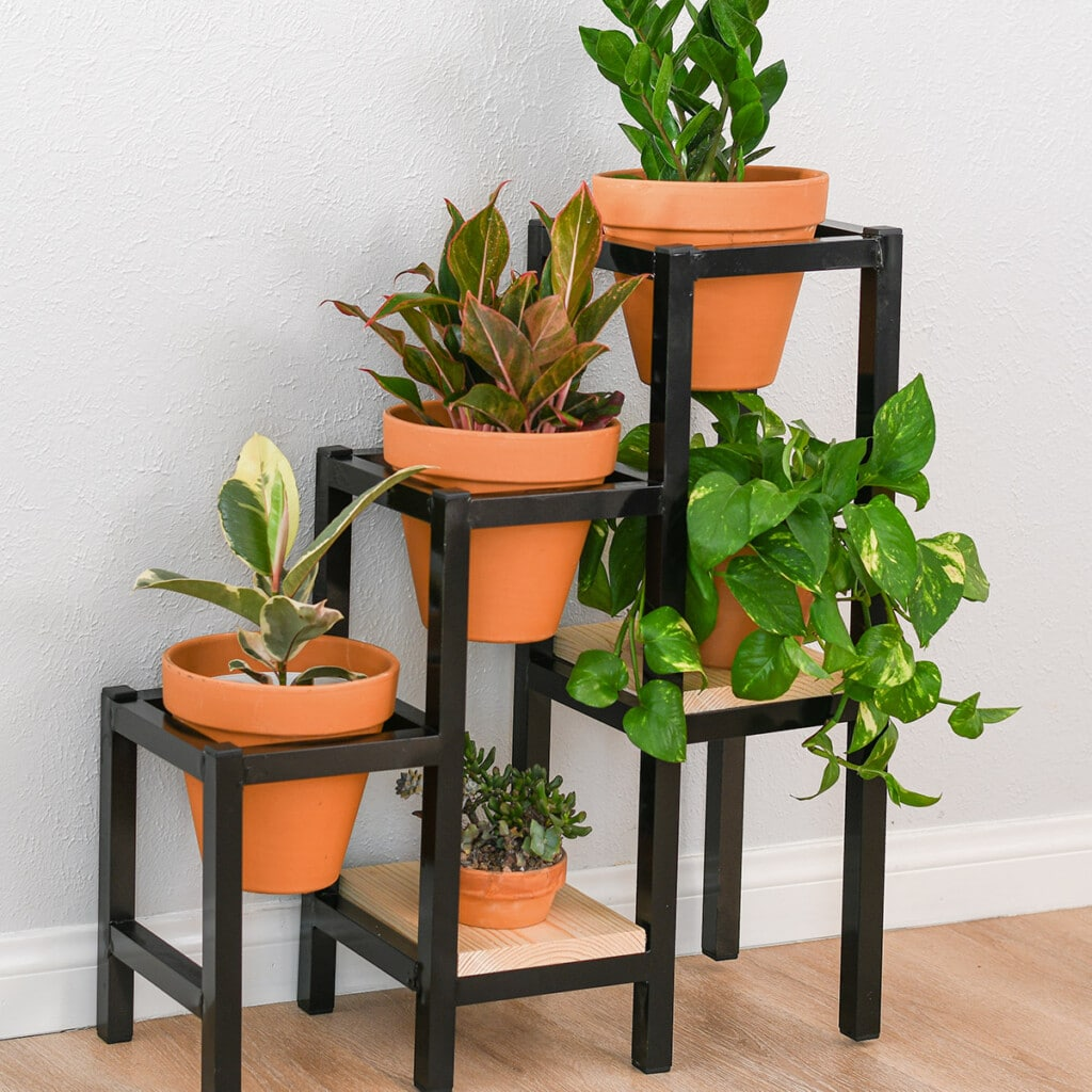 Learn how to build a DIY tiered metal plant stand using aluminum brazing with a blow torch with detailed tutorial, video and plans. It makes a great display for all your plants!