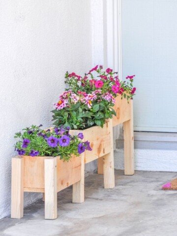 DIY tiered planter box planted with flowers