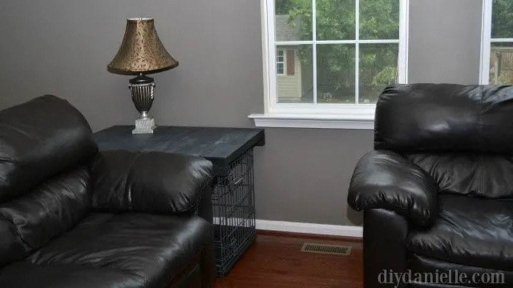 dog crate next to couch with wooden topper turning it into a side table