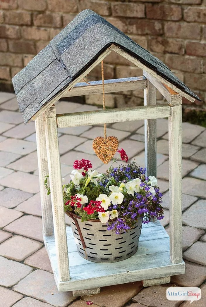 house shaped wooden bird feeder/plant atrium made from scrap 2x4s