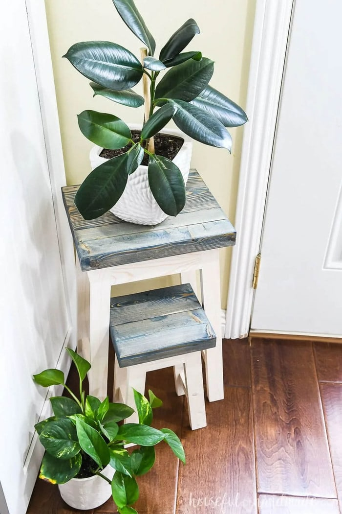 two plant stands made from scrap 2x4s