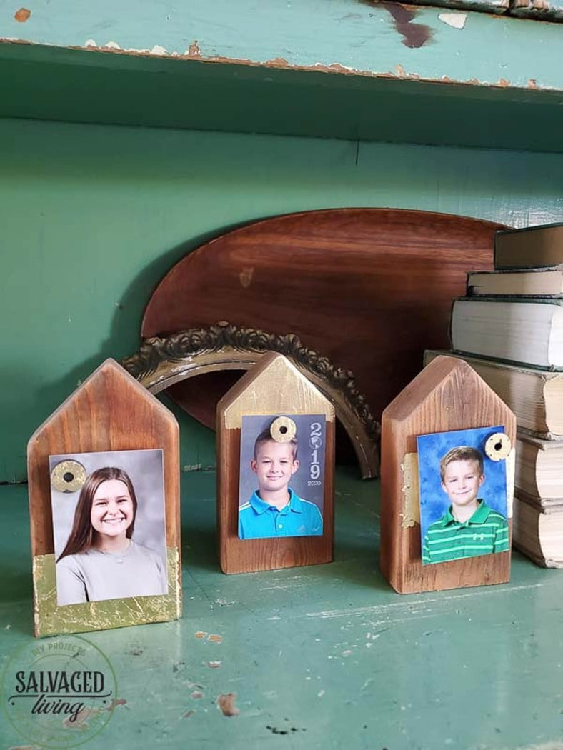 Three picture holder shaped like houses made from 2x4 scrap wood