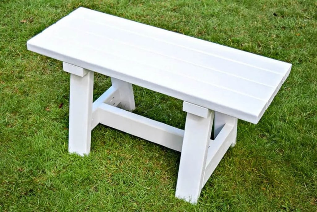 simple white farmhouse bench made from 2x4 scrap wood
