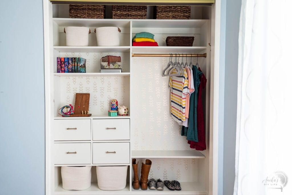 DIY Closet organizer with drawers in a reach in closet with sliding doors