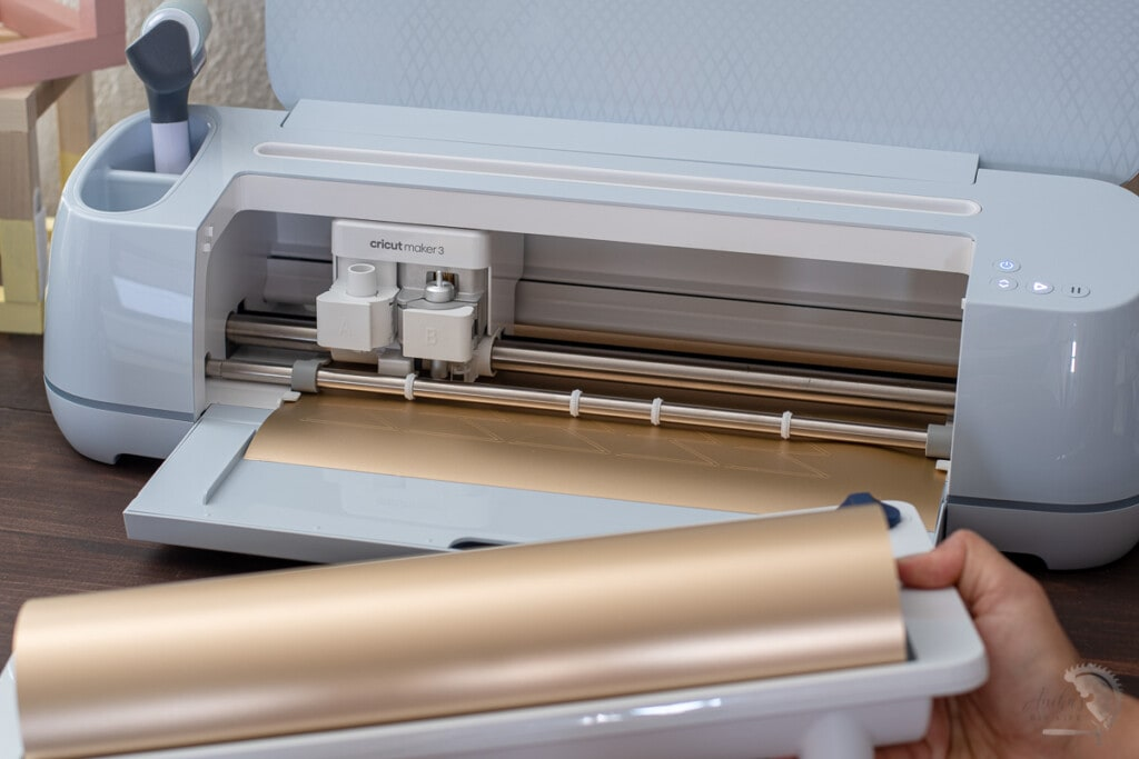 Woman removing the roll holder from the Cricut Maker 3