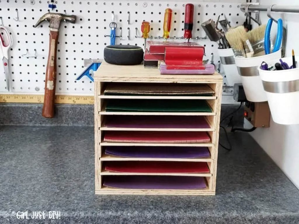 sandpaper storage rack sitting on a workbench