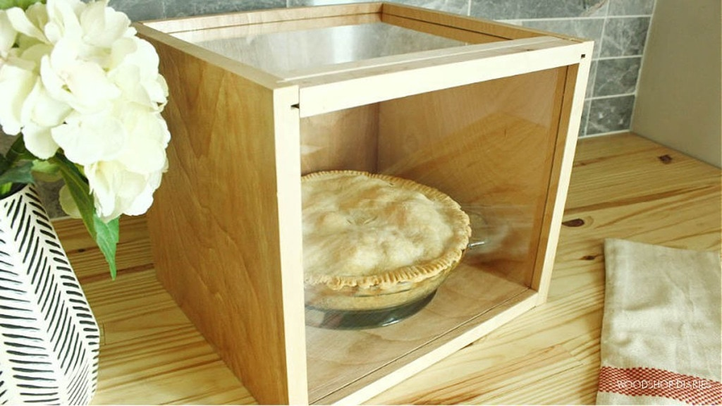 pie box made from scrap plywood and plexiglass with a pie sitting inside