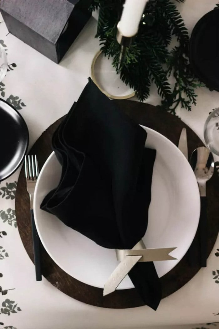 table setting using scrap plywood chargers painted black