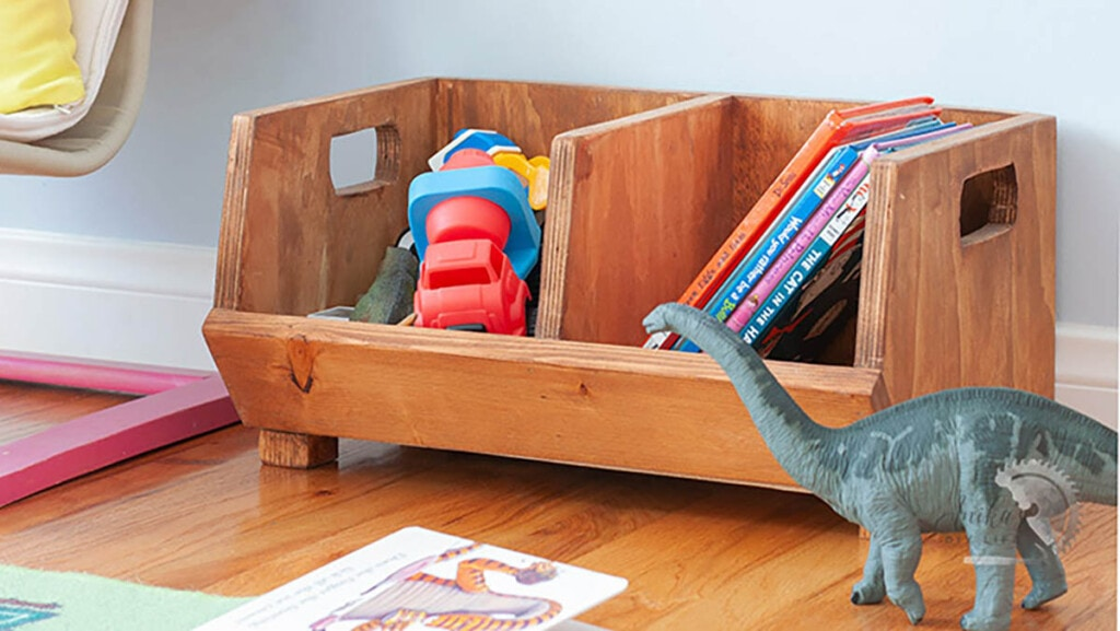 divided storage bin made from scrap plywood used for toys and books